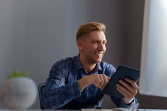 Cheerful office worker with tablet Stock Image