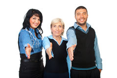 Cheerful office workers gives handshakes. Three business people standing with their hands straight for handshake and smiling isolated on white background, check stock photography