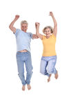 Cheerful old couple. Jumping on a white background Stock Image
