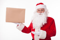 Cheerful old Father Christmas is congratulating Royalty Free Stock Photos