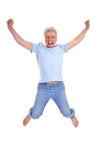 Cheerful old man jumping Stock Image