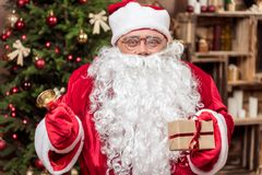 Cheerful old Santa Claus celebrating favorite holiday Stock Image