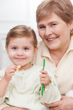 Cheerful old woman with her pretty granddaughter Royalty Free Stock Photography