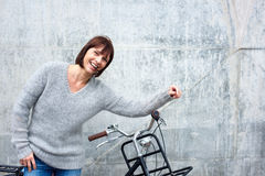 Cheerful older woman with bike Royalty Free Stock Photography
