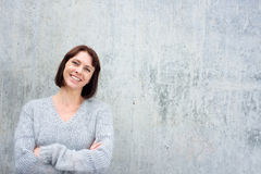 Cheerful older woman in wool sweater Royalty Free Stock Photos