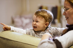 The cheerful one-year child points his finger Royalty Free Stock Images