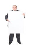 Cheerful overweight man with a blank sign Royalty Free Stock Photography