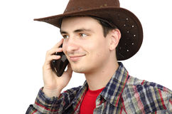 Cheerful paleface cowboy talking on smartphone Royalty Free Stock Images