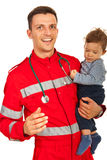 Cheerful paramedic holding baby Royalty Free Stock Images