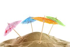 Cheerful parasols on the beach Royalty Free Stock Images