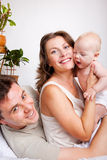 Cheerful parents and a baby Stock Photo