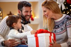 Cheerful parents with boy on holiday stock photography