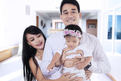 Cheerful parents and child at home Stock Photo