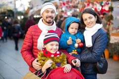 Cheerful parents with children choosing holidays decorations Royalty Free Stock Images