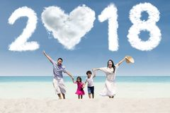 Cheerful family running under numbers 2018 Royalty Free Stock Images