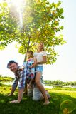 Cheerful parents with small laughing daughter having fun royalty free stock photo