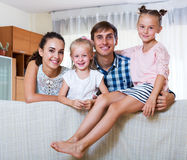 Cheerful parents with two daughters Stock Photo