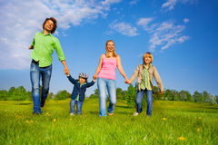 Cheerful parents walking with boys in park Royalty Free Stock Photography
