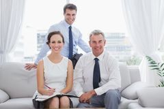 Cheerful partners posing while having a meeting Stock Photography