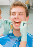 Cheerful patient. Young happy man at the sweet dentist Stock Photo