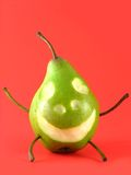 Cheerful Pear On Red Stock Photo
