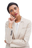 Cheerful pensive young businesswoman standing Royalty Free Stock Images
