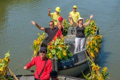 Cheerful people on a beautiful boat waving to the crowd. royalty free stock images