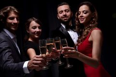 Cheerful people celebrating a sucess with Champagne Royalty Free Stock Image
