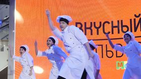 Cheerful people entertain guests dancing on stage. Kazan, Tatarstan/Russia - March 14 2018: cheerful people in costumes entertain guests dancing on stage at stock video