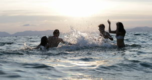 Cheerful People Group In Sea Splashing, Young Group Of Friends Having Fun During Vacation On Beach stock footage