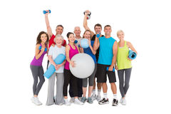 Cheerful people holding exercise equipment Stock Photography