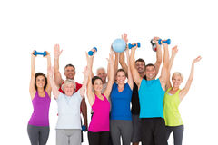 Cheerful people holding exercise equipment Stock Image