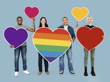 Cheerful people holding heart shape icon stock photo