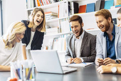 Cheerful people laughing in office Stock Images