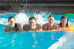 Cheerful people playing in the swimming pool Royalty Free Stock Images