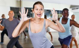 Free Cheerful People Practicing Vigorous Lindy Hop Movements In Dance Class Stock Photos - 156950943