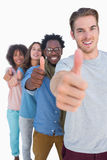 Cheerful people in row with thumbs up Royalty Free Stock Photography