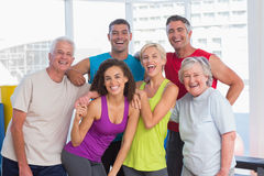 Cheerful people in sportswear at fitness gym royalty free stock photography