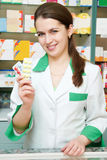 Cheerful pharmacist chemist woman royalty free stock photography