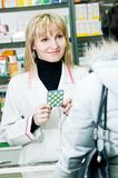 Cheerful pharmacist and client Royalty Free Stock Photo