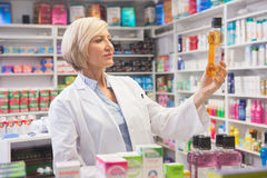 Cheerful pharmacist holding medication Royalty Free Stock Image