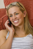 Cheerful Phonecall. A stunningly beautiful young blond woman chatting on her mobile phone Stock Image