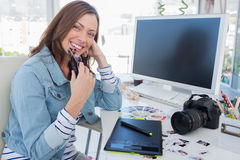 Cheerful photo editor with a graphic tablet Royalty Free Stock Photography
