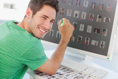 Cheerful photo editor pointing at his screen Stock Photography