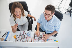Cheerful photo editors working on a computer. In their office Royalty Free Stock Image