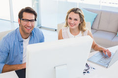 Cheerful photo editors working together on graphics tablet Stock Photos