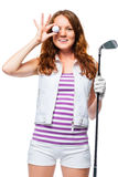 Cheerful photo of a golfer with a ball and putter on a white. Background Royalty Free Stock Photos