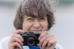 Cheerful photographer Stock Images