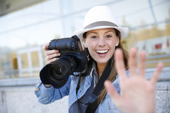 Cheerful photographer with reflex camera Stock Images