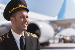 Brightly smiling airman standing outside Royalty Free Stock Photography